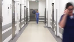 Time lapse video of busy doctors on the corridor