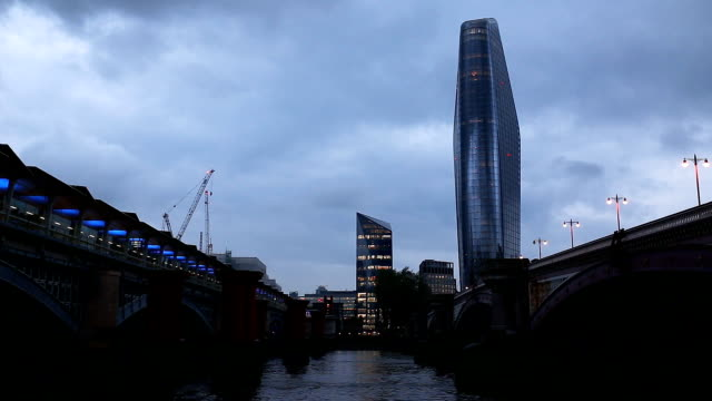 time lapse video of ferry passing under blackfriars bridge and moving clouds with one blackfriars - boomerang stock videos & royalty-free footage