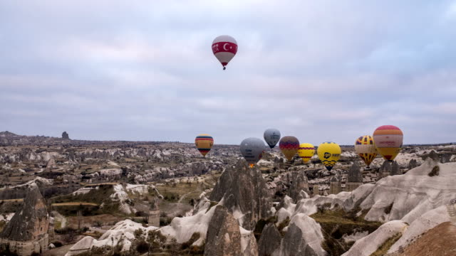 time lapse  video of hot air balloons flying in red and rose valley in goreme in cappadocia in turkey - rock hoodoo stock videos & royalty-free footage