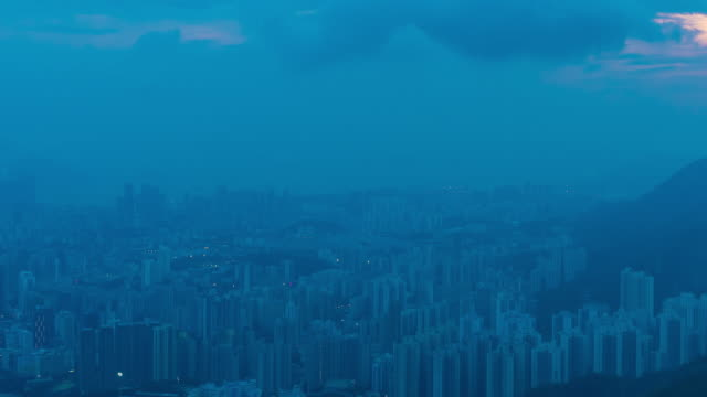 4K Time Lapse : view City skyline Hong Kong night aerial view of dense populated area of Kowloon