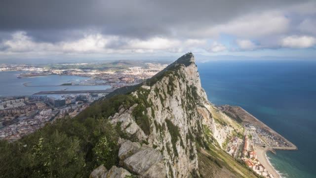 time lapse view northwards to the top of the rock of gibraltar, gibraltar, uk - gibraltar bildbanksvideor och videomaterial från bakom kulisserna