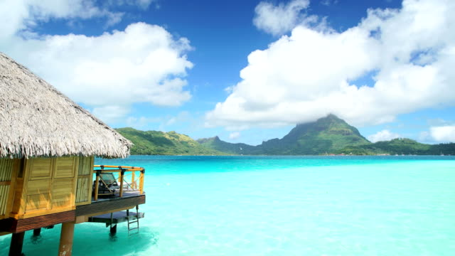 stockvideo's en b-roll-footage met time lapse view of aquamarine lagoon bora bora - polynesische etniciteit