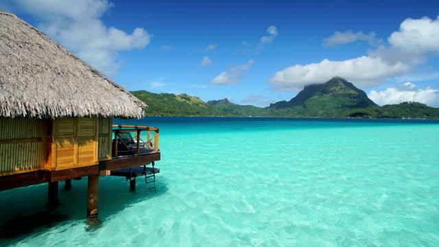 time lapse view of aquamarine lagoon bora bora - polynesian ethnicity stock videos & royalty-free footage