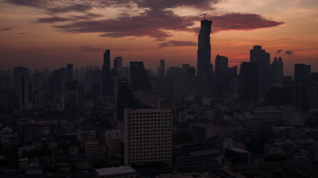 time lapse view of bangkok skyline at sunrise - distrust stock videos & royalty-free footage