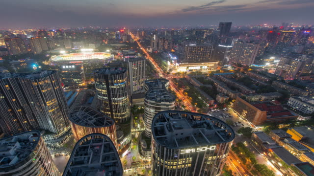 Time Lapse - View of Beijing CBD Sanlitun Area and Traffic, Dusk to Night Transition