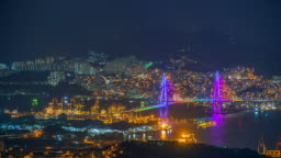 4K, Time lapse View of Busan at night with a bridge of South Korea