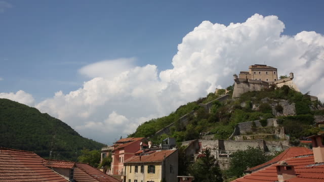 Time lapse view of clouds building around 15th C castle