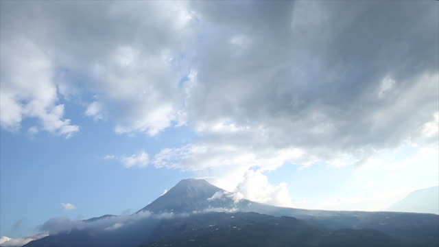 time lapse view of clouds passing above volcano summit - ecuador stock videos & royalty-free footage