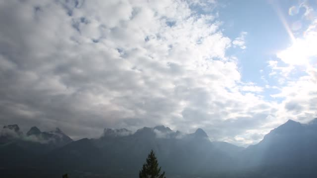 Time lapse view of clouds passing over mountains
