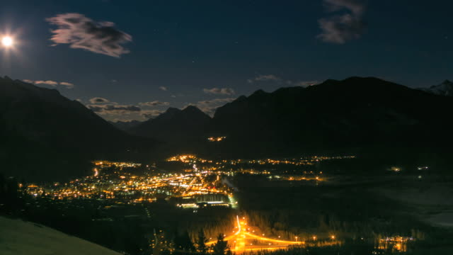Time lapse view of clouds passing overhead Banff town, night view