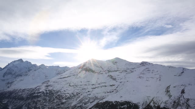 Time lapse view of clouds streaming past mountain summit