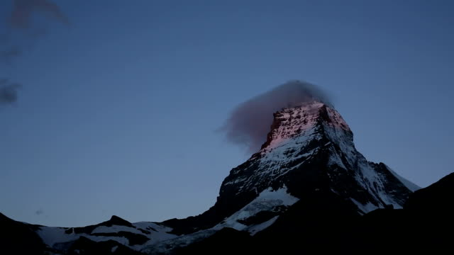 Time lapse view of clouds swirling around Matterhorn