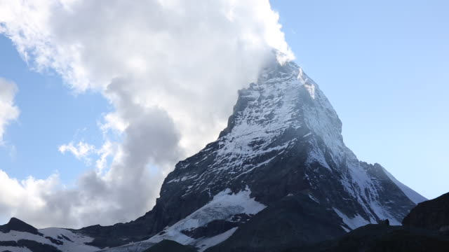 time lapse view of clouds swirling around the matterhorn - lockdown stock videos & royalty-free footage