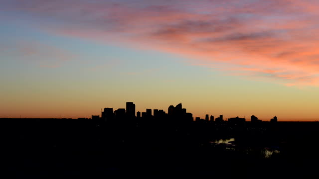 time lapse view of dawn breaking above city skyline - calgary stock videos & royalty-free footage