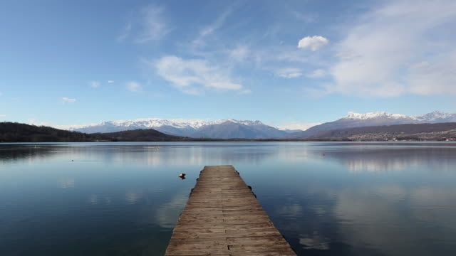 Time lapse view of dock protruding into lake