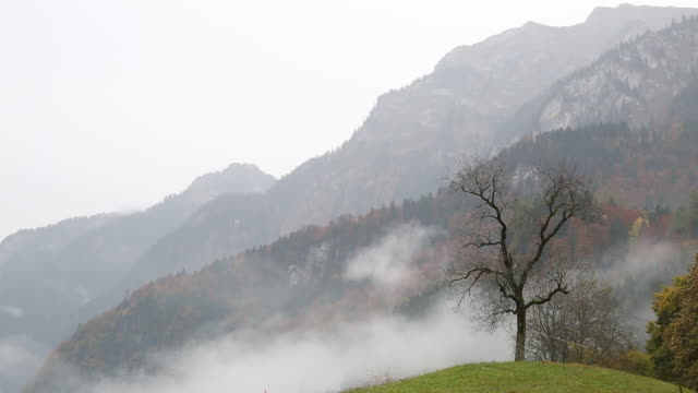 Time lapse view of fog rising in stormy mountains