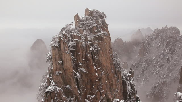 time lapse view of mountain mist and winter snow yellow mountains, huangshan, anhui province, china, asia,  - pine stock videos & royalty-free footage