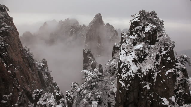 time lapse view of mountain mist and winter snow yellow mountains, huangshan, anhui province, china, asia,  - peter snow stock videos & royalty-free footage
