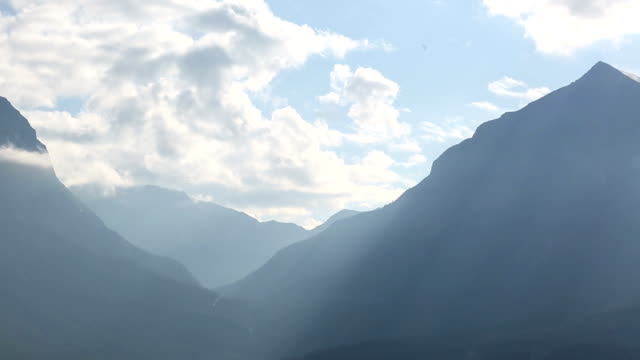 Time lapse view of mountains and valley from raised perspective