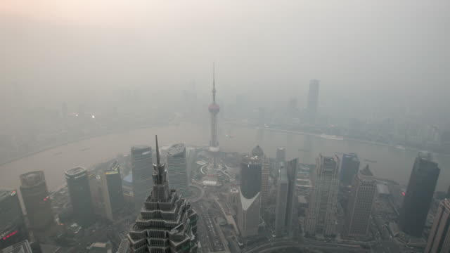 time lapse view of shanghai skyline / shanghai, china - shanghai world financial center stock videos & royalty-free footage