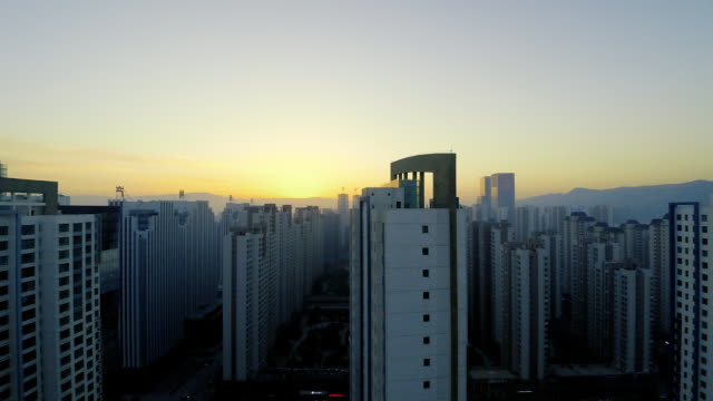 time lapse view of sunrise above urban area - pct stock videos and b-roll footage
