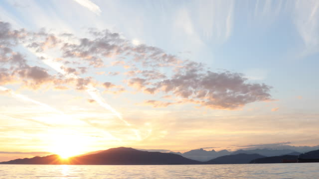 time lapse view of sunset over howe sound, vancouver harbour - vancouver canada stock videos & royalty-free footage
