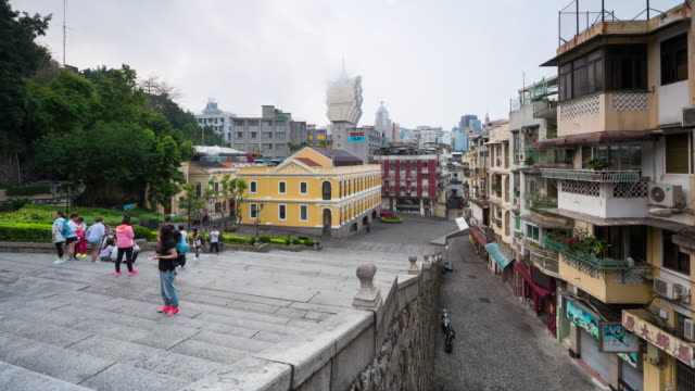 4k time lapse : view of the historical district of macau, a former portuguese colonial city and now popular destination for tourism - macao flag stock videos and b-roll footage