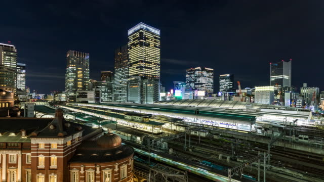 time lapse - view of tokyo station and modern skyscrapers / tokyo, japan - railway station stock videos & royalty-free footage