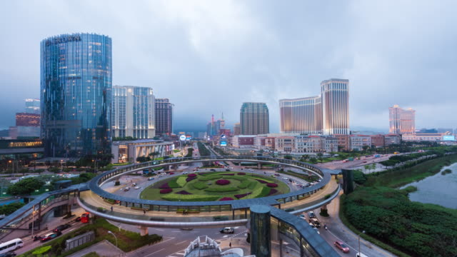 4K Time Lapse : View of traffic driving past the largest casino in the world, the Venetian in Macau