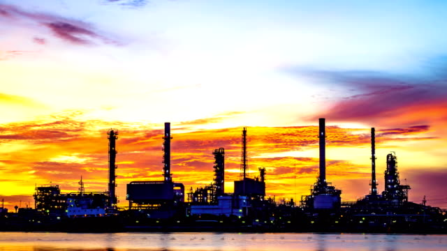 time lapse: view refinery with river reflection - oil rig supply ship stock videos and b-roll footage