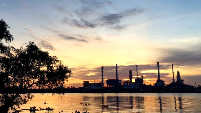 Time lapse: view refinery with river reflection