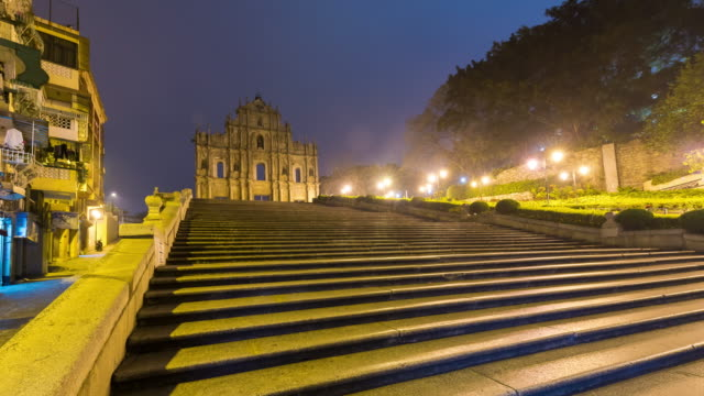 4k time lapse : view sunrise of saint paul's church at macao china - macao flag stock videos and b-roll footage