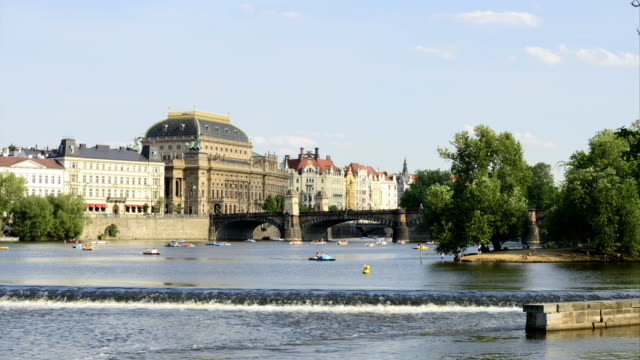 4k time lapse vltava river in prague - czech culture stock videos & royalty-free footage