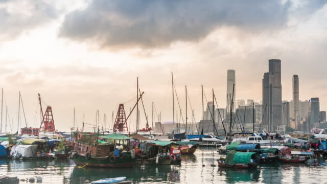 time lapse: wanchai ferry pier during sunset in hong kong - star ferry stock videos & royalty-free footage
