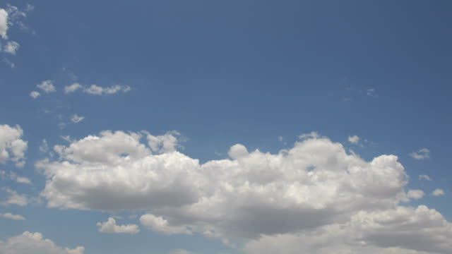 time lapse white clouds float across a summer blue sky. - sky only stock videos & royalty-free footage