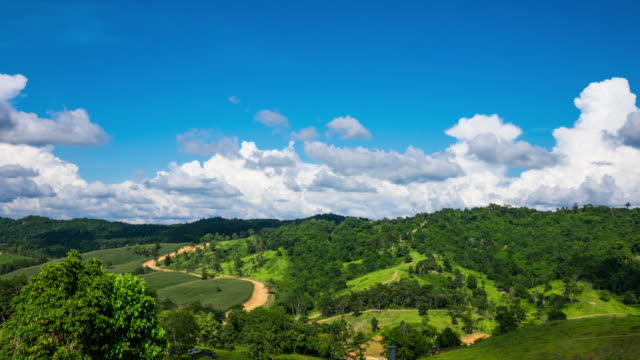 time lapse, white clouds passing over green hills - prairie stock videos & royalty-free footage