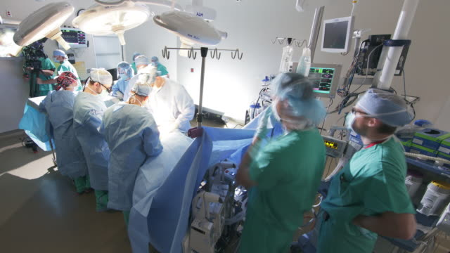 time lapse wide angle surgical procedure in operating  room - medical procedure stock videos and b-roll footage