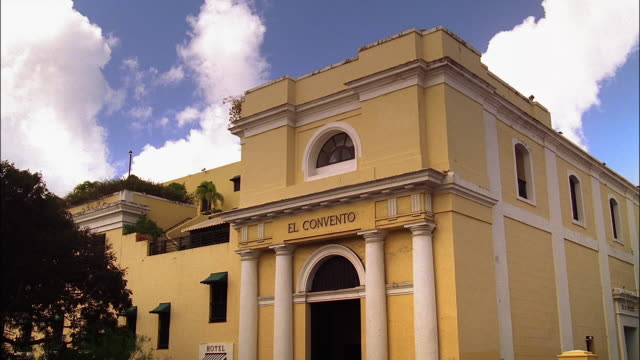 time lapse wide shot clouds drifting over hotel and former carmelite convent el convento / old san juan, puerto rico - convent stock videos & royalty-free footage