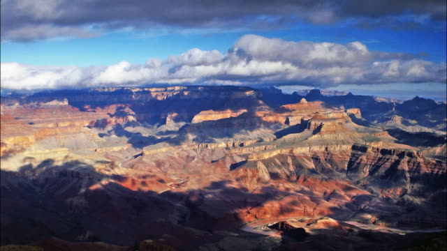 time lapse wide shot clouds passing over grand canyon / grand canyon national park, arizona - grand canyon national park bildbanksvideor och videomaterial från bakom kulisserna