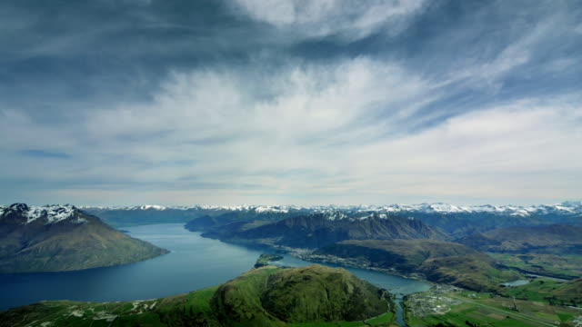time lapse wide shot clouds rolling over lake wakatipu viewed from the remarkables / queenstown, new zealand - otago region stock videos & royalty-free footage
