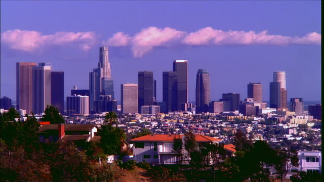 Time lapse wide shot downtown skyline as seen from the Hollywood Hills / Los Angeles, California
