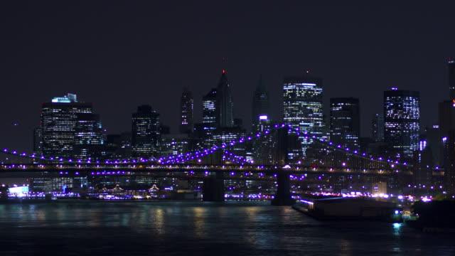 time lapse wide shot of williamsburg bridge and manhattan skyline at night.  - manhattan stock videos & royalty-free footage