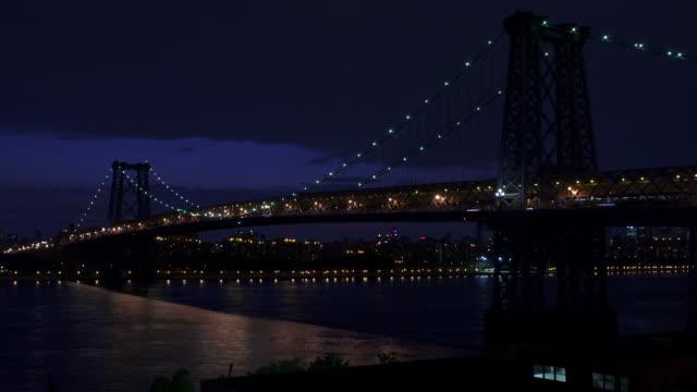 Time lapse wide shot of Williamsburg Bridge at night