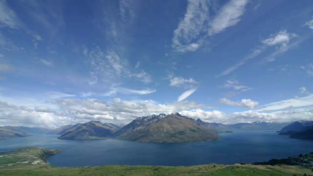 time lapse wide shot overlooking lake wakatipu from deer park heights as clouds roll in / new zealand - stratocumulus stock videos and b-roll footage