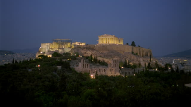Time lapse wide shot Parthenon on the Acropolis / day to night / Athens, Greece