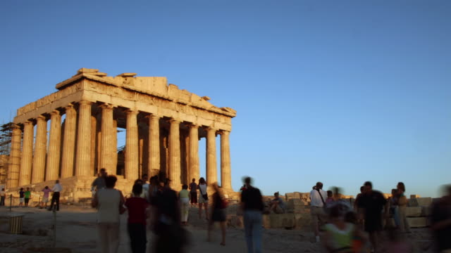 Time lapse wide shot tourists walking outside the Parthenon at the Acropolis / Athens, Greece