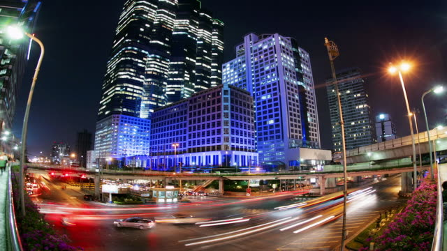time lapse wide shot traffic outside chong nonsi station on sathorn nua and sathorn tai roads / night / bangkok, thailand - cinematography stock videos & royalty-free footage