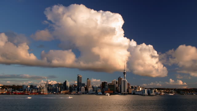 Time lapse wide shot view of clouds moving over the city of Auckland from Stanley Point / New Zealand