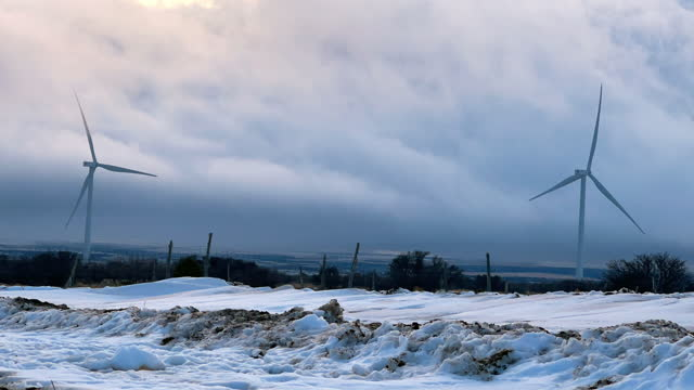 time lapse wind turbines, wind farm near monticello, utah on a foggy, snowy, windy winter day - mill stock videos & royalty-free footage