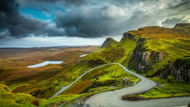 Time Lapse : Winding road at high cliffs and plateaus of the Quiraing in Scotland